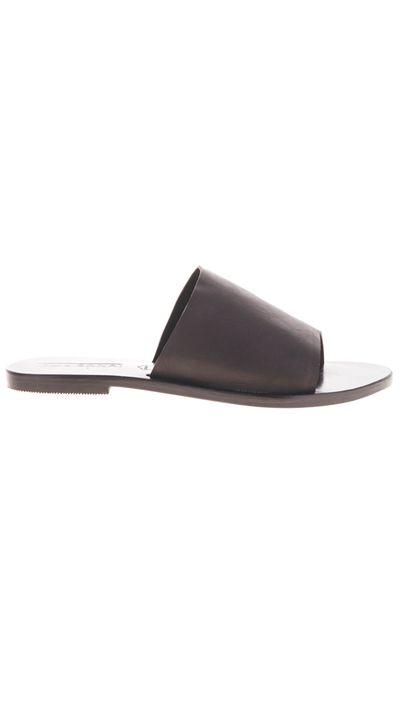 "<a href=""http://www.sol-sana.com/product/teresa-slide-black/"" target=""_blank"">Slides, $99.95, Sol Sana</a>"