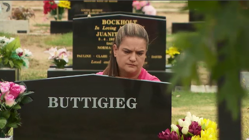 Ms Saunders at her daughter's grave. (9NEWS)