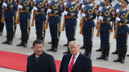 Donald Trump, right, walks with Chinese President Xi Jinping during a welcome ceremony at the Great Hall of the people in Beijing.