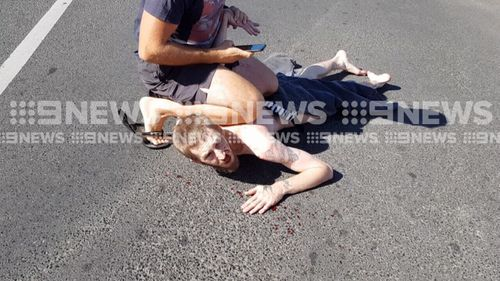 Moments before stripping off, the driver allegedly crashed into another car. (9NEWS)