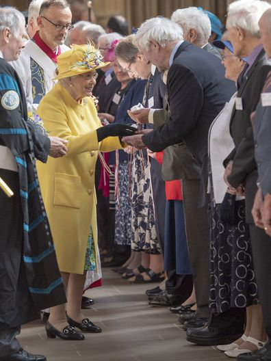 Queen Elizabeth II distributes the Maundy money at the traditional Royal Maundy Service at St George's Chapel on April 18, 2019 in Windsor, England