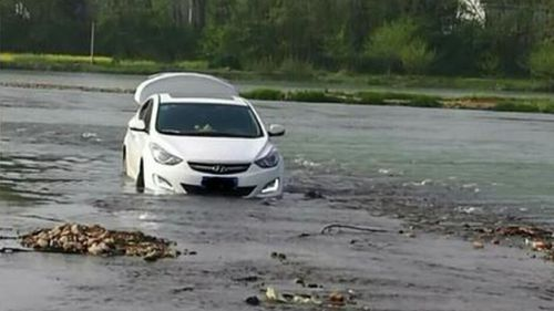 Man following GPS instructions drives car into Chinese river