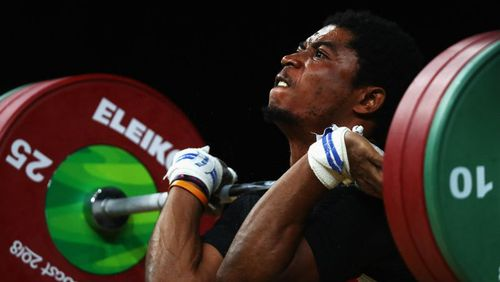 Olivier Heracles Matam Matam of Cameroon competes during the weightlifting men's 62kg final. (Getty)