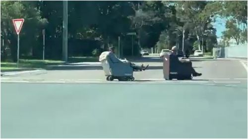 Two men were filmed riding motorised lounge chairs through the streets of Newcastle.