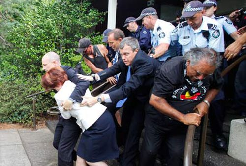 Julia Gillard escapes the furious mob, after being attacked at a function. (AAP)