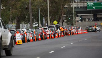 A line of cars as people wait to get tested in South Melbourne.