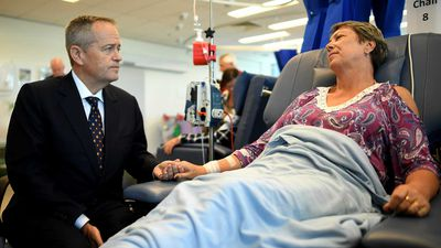 Bill Shorten speaks to cancer patient Judy Dixon during a visit to Redcliffe Hospital in Brisbane.