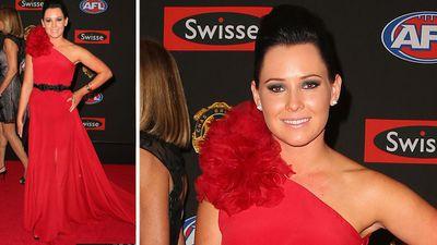 Michael Barlow of Fremantle's partner Leah McKenzie was bold in her red dress. (AAP)