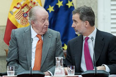 King Felipe VI of Spain (R) and King Juan Carlos (L) attend a meeting with COTEC Foundation at the Royal Palace on May 14, 2019 in Madrid.