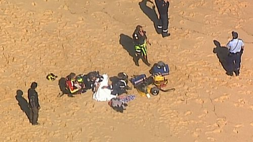 Emergency Services were called when the boat flipped and began to sink off the coast of Little Marley Beach in Sydney's Royal National Park.