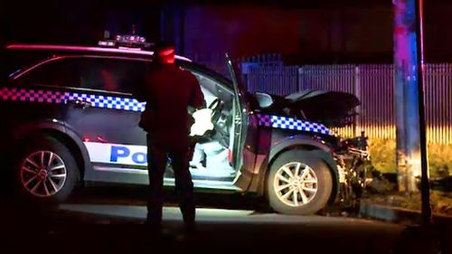 The police vehicle collided with a pole after a short pursuit.