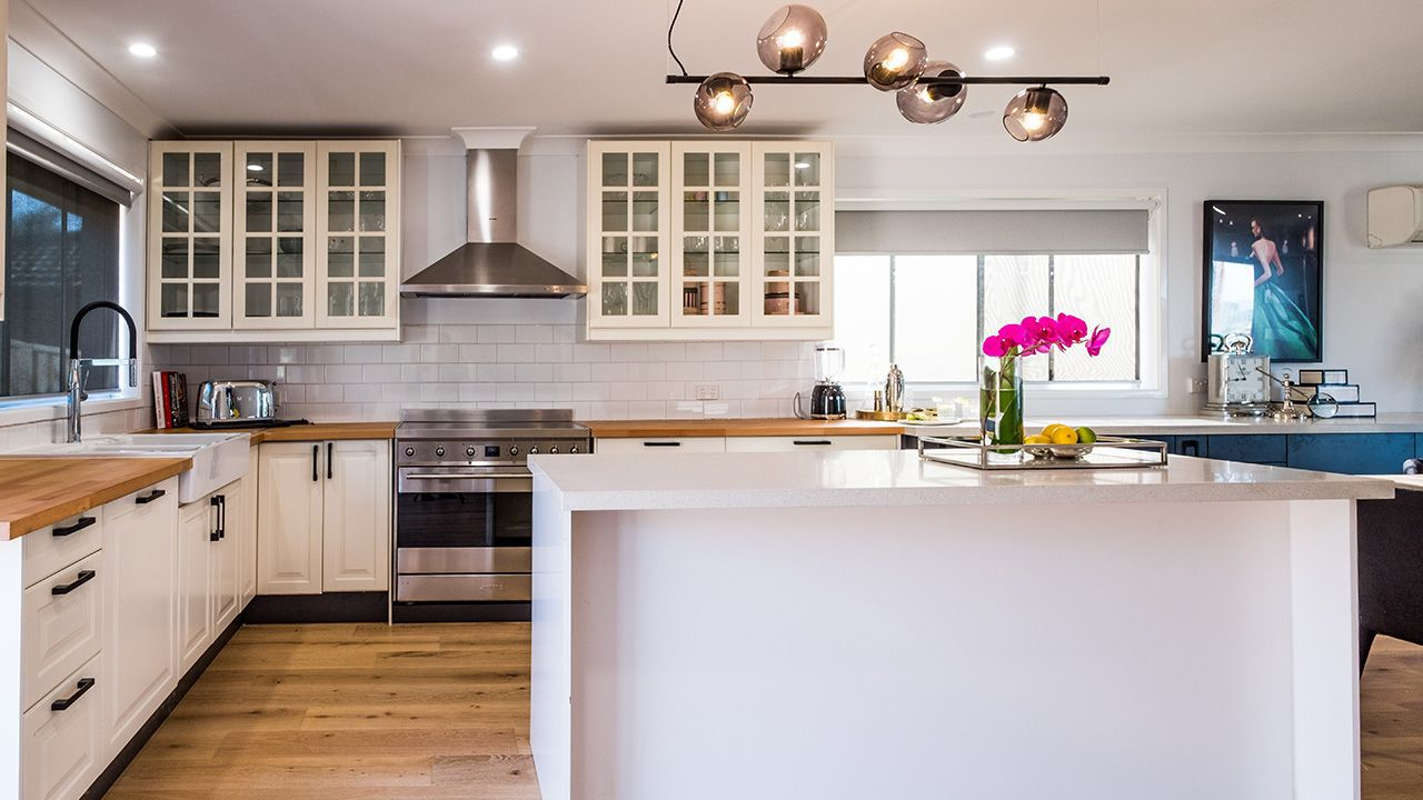 AFTER: The new kitchen with its abundance of natural light (plus nice light fixture)