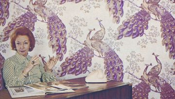 Designer Florence Broadhurst in the 1960s with her peacock wallpaper.