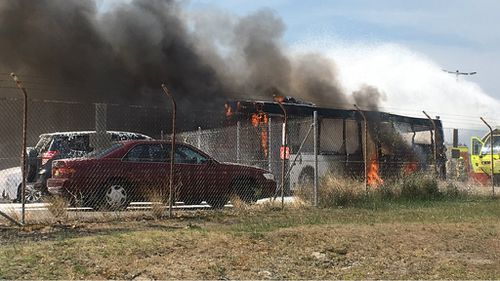 A witness captured this image of the bus on fire. (Timothy Jones/Supplied)