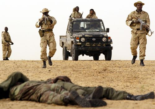 Malian soldiers from the 512th Motorised Infantry company enact an ambush exercise under the supervision of US Special Forces in the desert near Timbuktu in Mali
