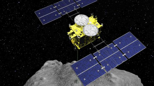 This computer graphics image released by the Japan Aerospace Exploration Agency (JAXA), shows how the Hayabusa2 spacecraft released an explosive onto an asteroid to make a crater on its surface and collect underground samples.