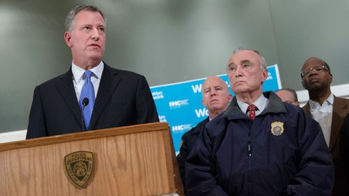 New York City Mayor Bill de Blasio, left, speaks alongside NYPD Commissioner Bill Bratton. (AAP)