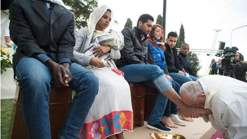 The pope washed the feet of 11 people at the Castelnuovo di Porto. (AAP)