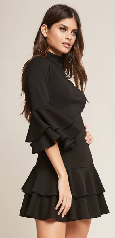 """<a href=""""https://www.forever21.com/us/shop/Catalog/Product/f21/dress_black-dresses/2000249474"""" target=""""_blank"""">Forever 21 Tiered Bell-Sleeve Flounce Dress, $38.</a>"""