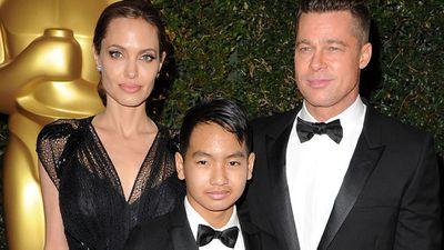 <p>Maddox Jolie-Pitt and Angelina Jolie</p>