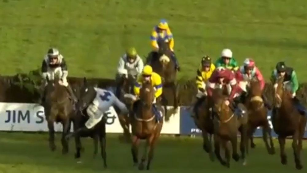 Teenage jockey Jack Kennedy falls off ride but still manages to stay aboard and win