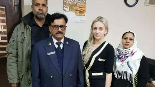 Tereza Hluskova, pictured smiling with customs officials at Lahore Airport.
