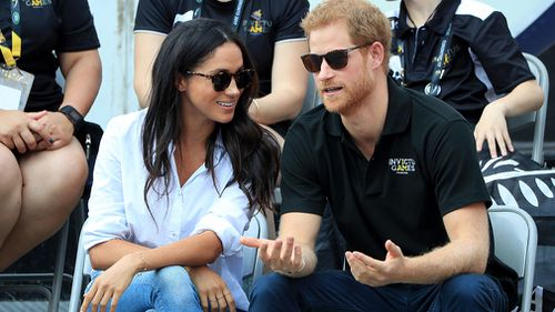 The young couple chat on the sidelines. (AAP)