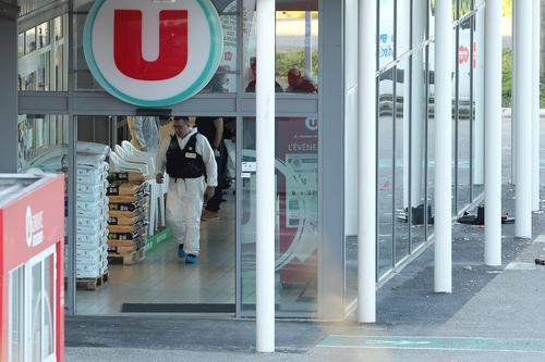 Forencis officers are combing the supermarket in Trebes where the gunman took hostages during the rampage. (AAP)