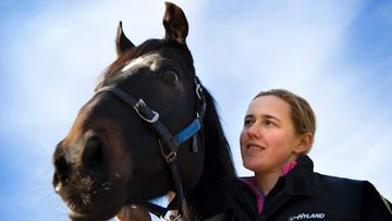 Family and friends don purple to farewell beloved young jockey