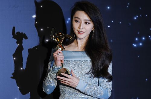 Chinese actress Fan Bingbing poses after winning the Best Actress Award of the Asian Film Awards in Hong Kong. (AAP)