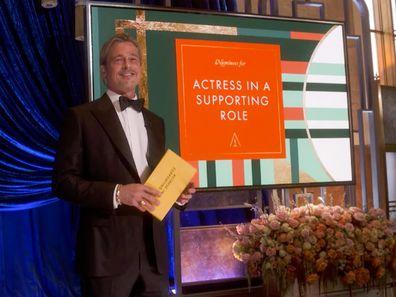 Brad Pitt presents at the 2021 Oscars