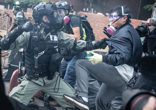 The pitched battle for control of Hong Kong Polytechnic University began last week as demonstrators for days fortified the campus to keep the police out. On Monday, cornered by security forces determined to arrest them, they desperately tried to get out but faced a cordon of officers armed with tear gas and water cannons.