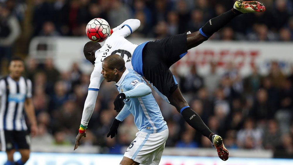 Manchester City's Fernando and Newcastle United's Papiss Cisse battle for the ball. (AAP)
