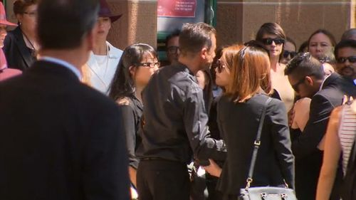 A crowd of weeping mourners gather for Mr Johnson's funeral. (9NEWS)