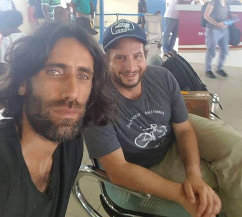 Dan Ilic and Behrouz Boochani at Manus Island Airport.