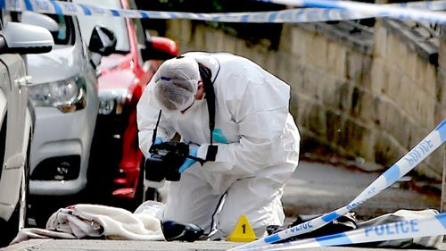 Forensic police collect evidence from the crime scene. (AAP)