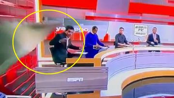 ESPN journalist crushed by falling set piece during live broadcast