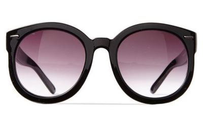 "Pop on a pair and you'll add that touch of Hollywood plus hide any under-eye circles. Being pregnant is exhausting. <a href=""http://cottonon.com/AU/p/cotton-on-women/farrah-round-sunglasses/2024816601990.html?region=AU#start=1"" target=""_blank"">Cotton On Farrah Round Sunglasses, $20 for two pairs.</a>"