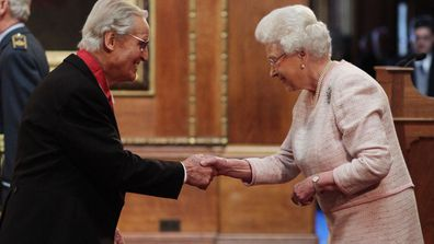 File photo dated 15/4/2104 of entertainer Nicholas Parsons is made a Commander of the Order of the British Empire (CBE) by Queen Elizabeth II during an Investiture ceremony at Windsor Castle, Berkshire