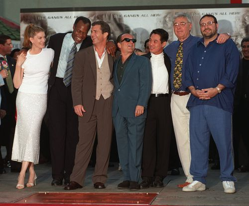 Glover and Mel Gibson with the cast from Lethal Weapn 4 in 1998. Picture: AAP