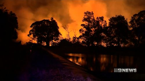 Fierce winds gusting up to 90km/h pushed the fire straight towards Tathra late yesterday, taking locals and emergency workers by surprise. Many had just minutes to escape. (Supplied)