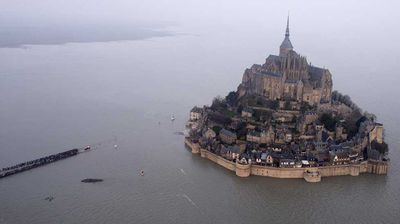 """<p>This is the moment 30,000 people flocked to Mont Saint-Michel to witness, as the """"tide of a century"""" swelled around the picturesque medieval French landmark.</p><p> Like the spring tide that would follow, the record-breaking crowd flooded onto a near-kilometre-long footbridge linking the rocky island with the mainland to watch a wall of water as high as a four-storey building swept up the bay on the Normandy coast.</p><p>Click through for more.</p>"""