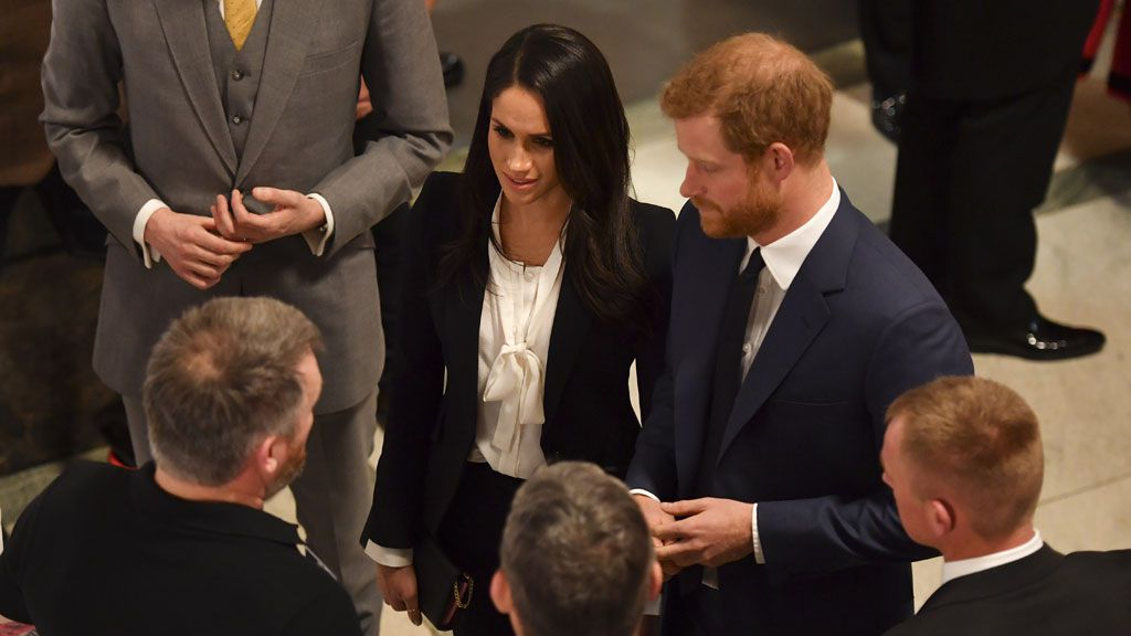 Meghan Markle Wore a Suit Alongside Prince Harry at Their First Red Carpet Event