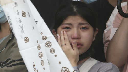 The families of the victims in a train crash cry as they mourn near Taroko Gorge in Hualien, Taiwan