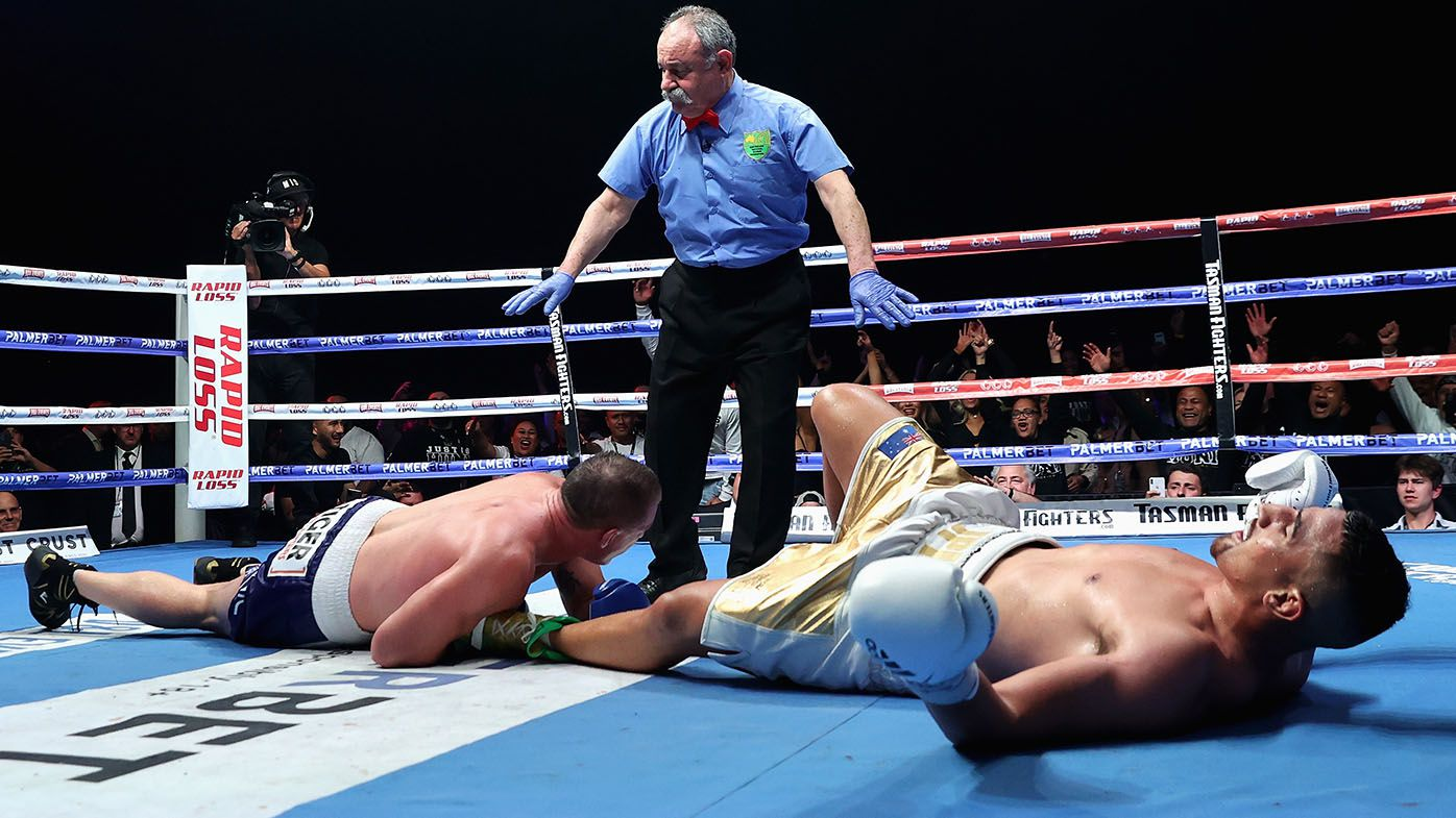 Paul Gallen tackles Justis Huni in 10th round of their fight, just before TKO loss