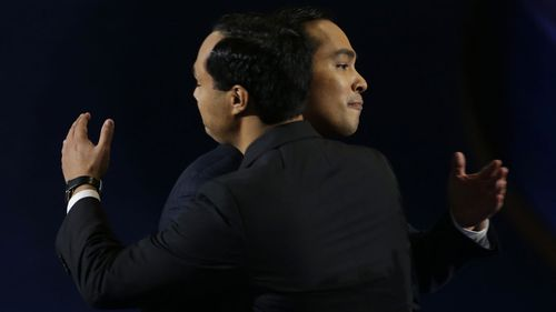Julian Castro embraces his identical twin brother Joaquin.