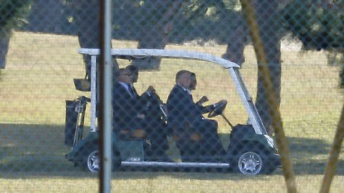 Mr Trump and Mr Abe golfing in Japan. (AAP)