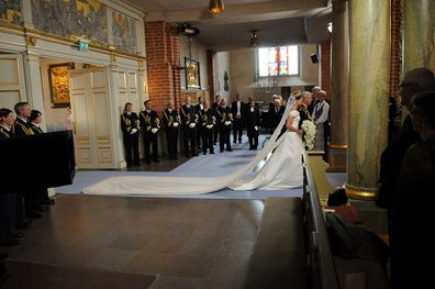 Crown Princess Victoria of Sweden is led into the church by her father the king Carl Gustaf of Sweden.