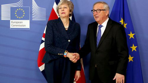 British Prime Minister Theresa May is icy as she shakes the hand of European commission President Jean-Claude Juncker.