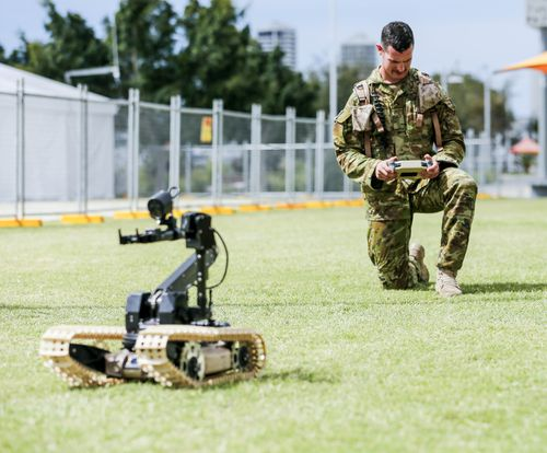 Police and ADF members have been given additional powers to conduct random searches and patrol airport-like security across 15 venues around the Gold Coast. Picture: AAP.